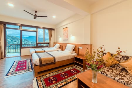 SUPER DELUXE ROOM WITH BALCONY OVER LOOKING THE VALLEY. THE ROOMS HAVE ALL THE AMENITIES AND ARE CLEAN AND AIRY.