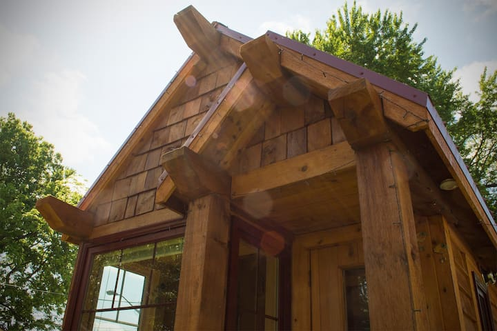 Purlins add an aesthetic touch to the arts and crafts inspired tiny bungalow.