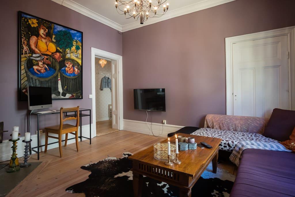 Cozy livingroom as seen from bedroom door