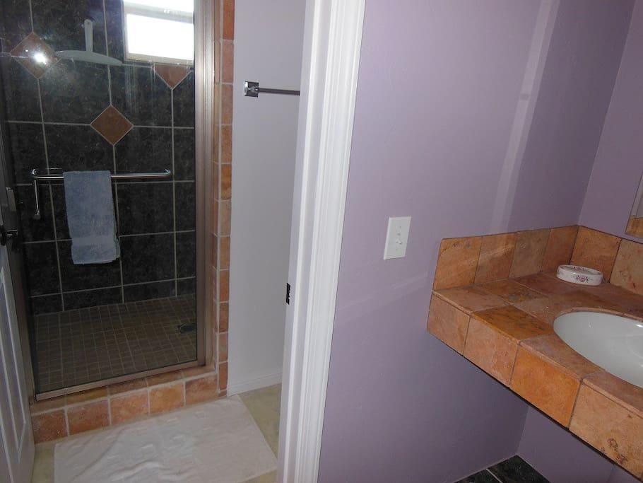 Cuetzalan's walk-in shower and separate vanity