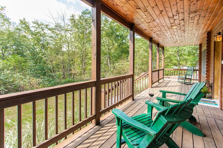 "3...2...1... relax! Enjoy the peace of nature from the cabin porch with your morning coffee or a glass of wine. Wooden rockers and adirondack chairs provide the perfect spot to read, unwind, or simply ""sit a spell"" as they say down here."