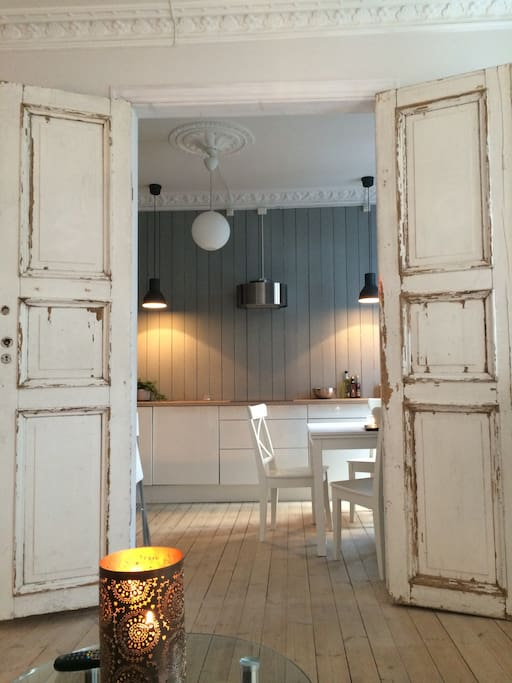 Old wooden doors gives the apartment an old style charm