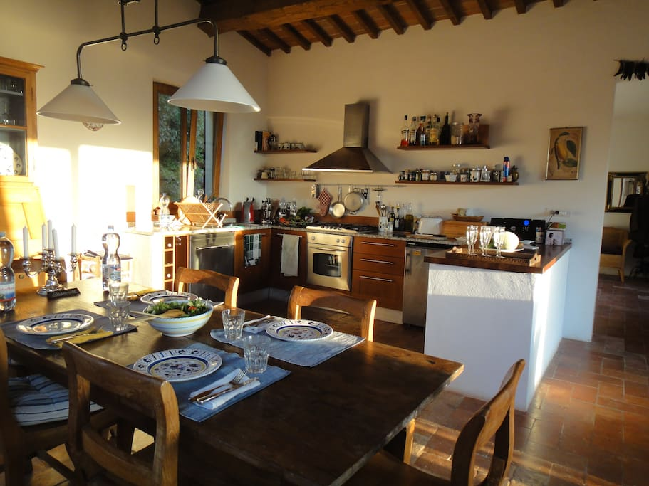 Warm kitchen wich is fully equiped for cooking and view  to the sea