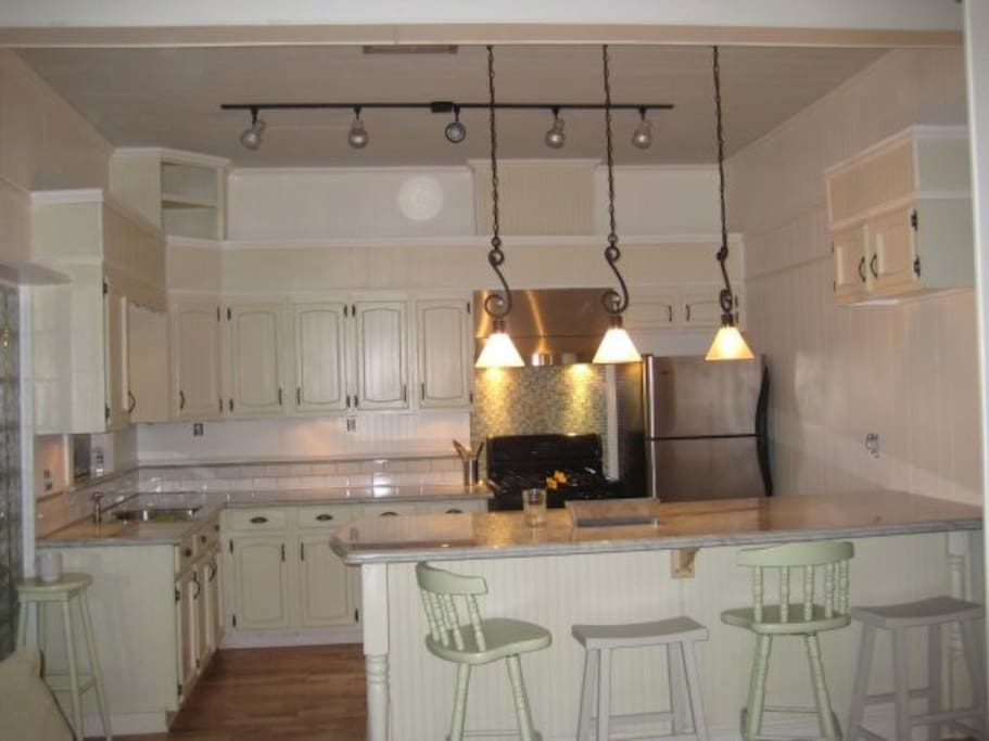 Gourmet kitchen with marble top to make bakery