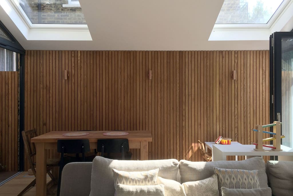 Beautiful oak battened wall with copper lights