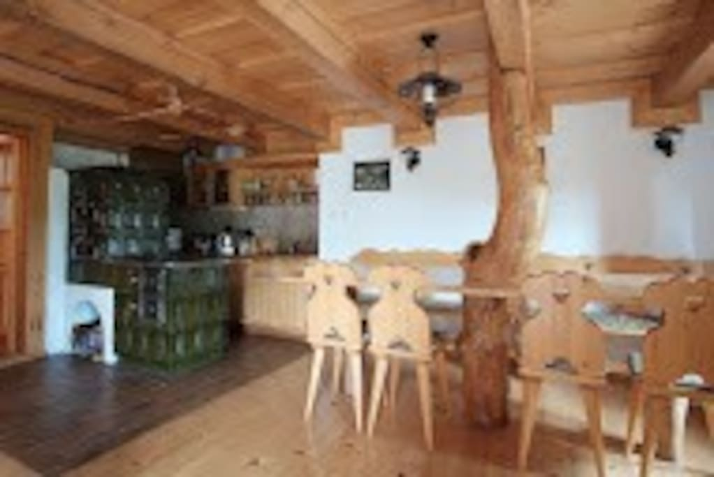 Large kitchen table with the tree in the middle