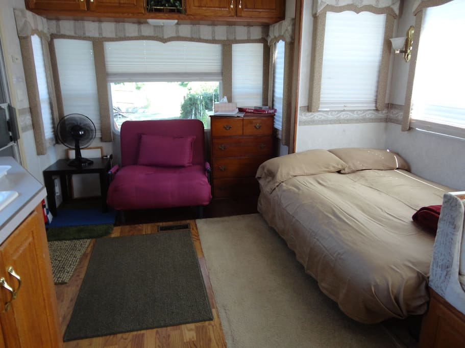 Living area with the futon double bed opened into a bed.