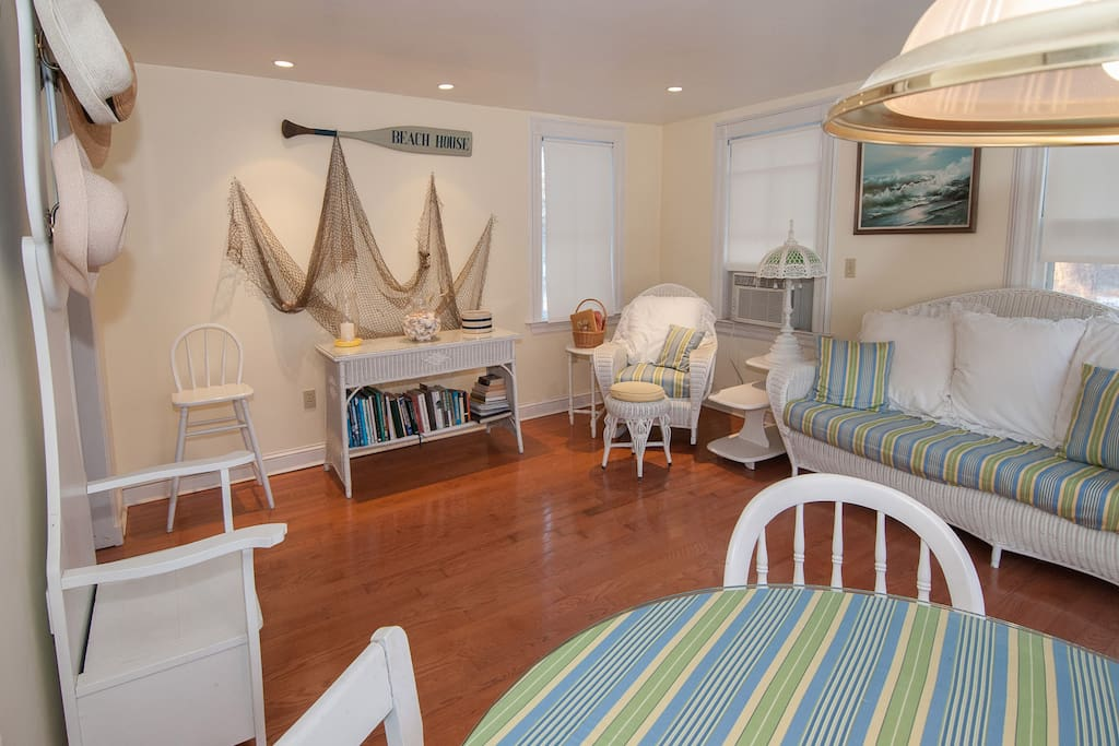 Glorious sun room greets you when you arrive. Antique white wicker furniture and rocking chair for reading.