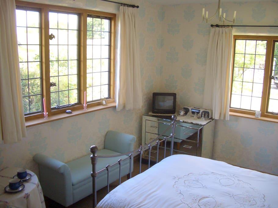 Guest Room - oak floors, sheepskin rugs, mountain view