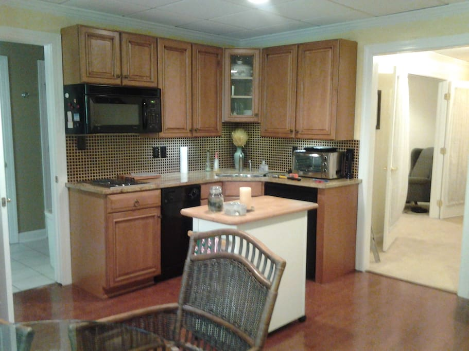 Kitchen includes dishwasher, microwave, fridge, toaster/oven, granite counter tops!! Also eat in with table and 4 chairs, and a desk.