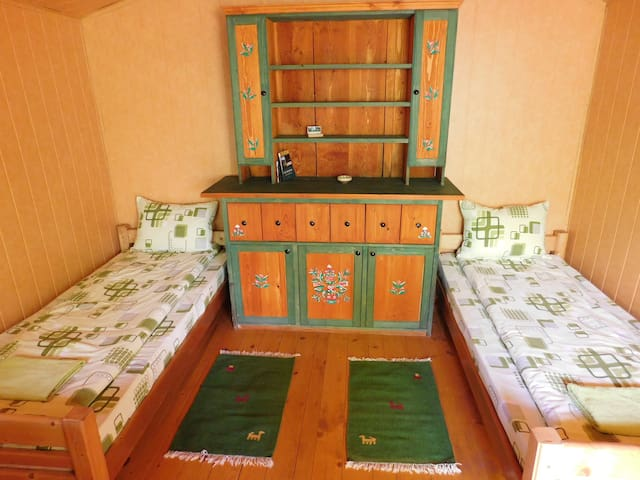 Twin beds in wooden cabin