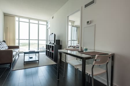 Located in the heart of downtown Toronto.  Steps to public transit and nightlife.  Great view of harbourfront and Lake Ontario.  3 floors of great amenities including whirlpool and massage therapy services.