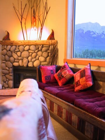 CONDO #1: Curl up on barnwood window bench next to the fireplace