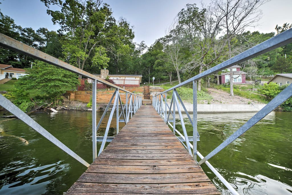 Life is better at the lake in this 2-bedroom, 1-bathroom waterfront vacation rental home on the Little Niangua River.