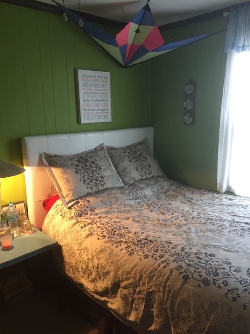 Very comfortable queen size bed with The Outer Banks dreamcatcher above.