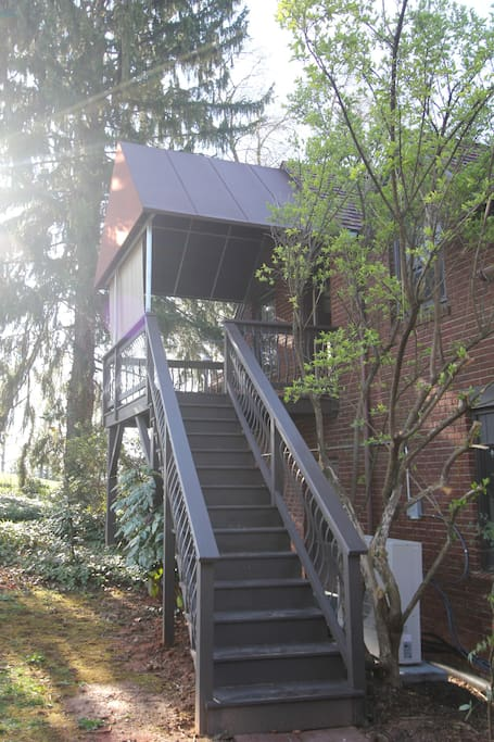 Tucked above the Carriage House with it's own private entrance behind the building.