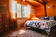 The panoramic bedroom window looks out unobstructed into the National Forest – the first thing you see when you wake up in the morning.