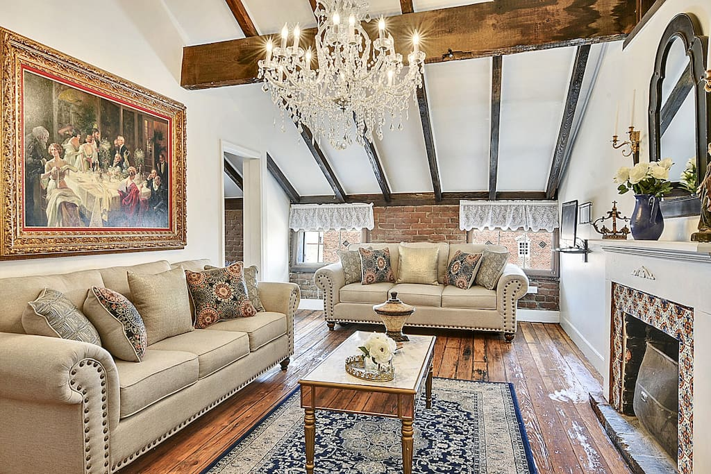Cathedral ceilings, original wood beams, French chandelier,