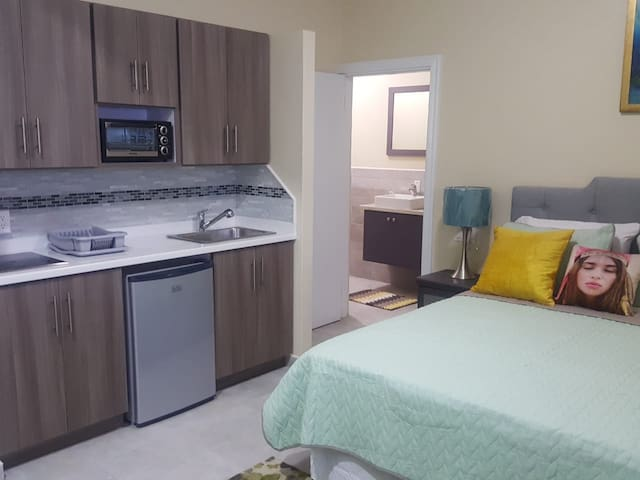 Kitchenette complete with new and modern appliances, cutlery, cooking utensils etc.