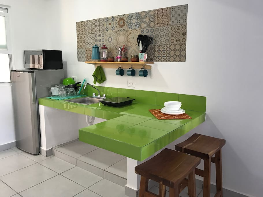 The kitchen is very spacious and has all the basic utensils to cook a great breakfast and a tasty dinner.