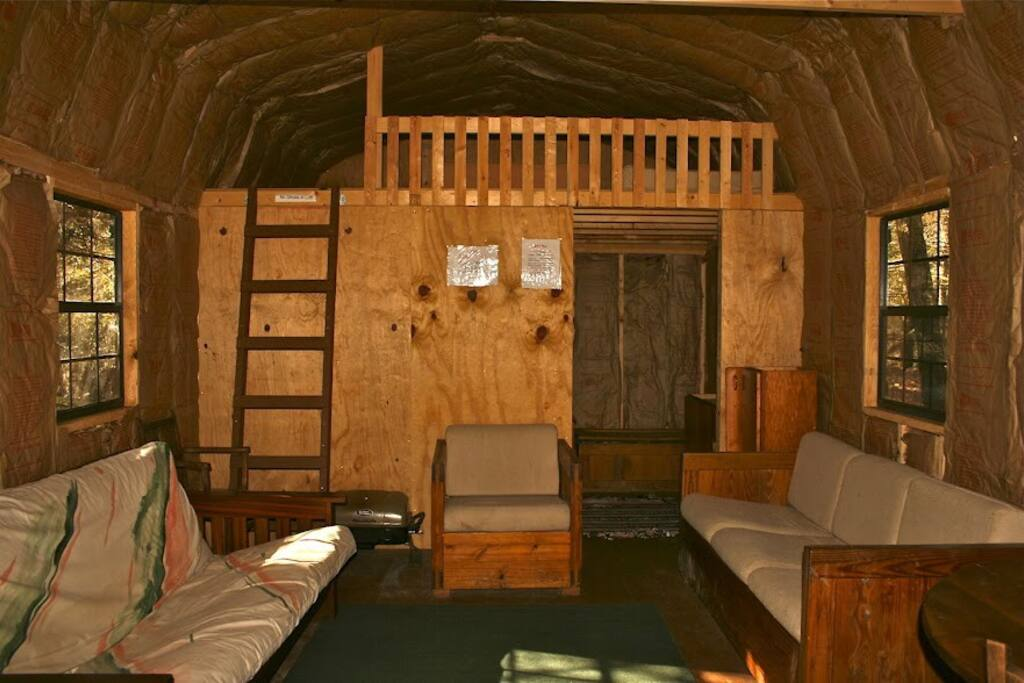 This large cabin has lots of room to spread out with comfy furnishings and a big back loft