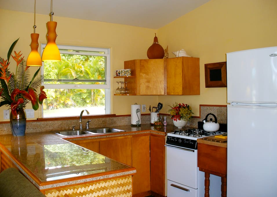 The kitchen is complete with pots/pans, dishware and cutlery. It has everything you need to prepare a nice meal in your hale (home) away from home