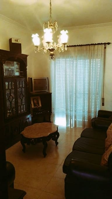 Vintage living room connects with a very nice balcony. 3 Sofas, and TV and WIFI available.