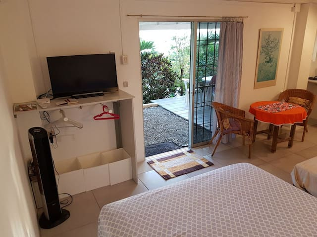 From the bed you can easily see the TV as well as the view through the sliding glass doors.