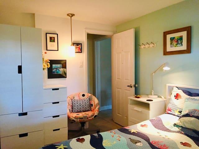 Separate bedroom with plenty of storage.