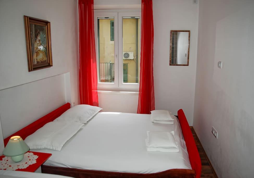 red bedroom full of light