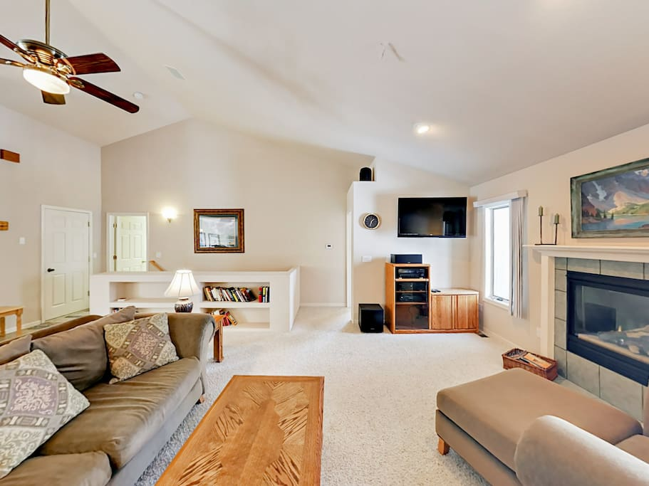 A bright and contemporary main living space has seating for 4. Home is professionally managed by TurnKey Vacation Rentals.