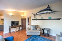 The marlin hanging on the wall gives the space a coastal flair!