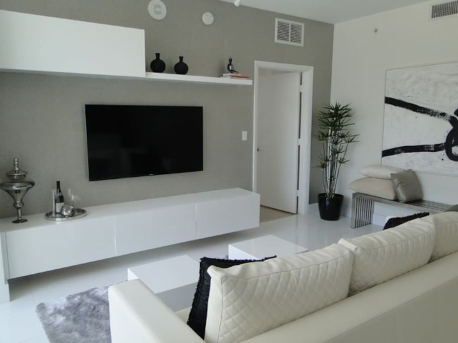 """Comfortable lounge room with 60"""" Smart TV"""
