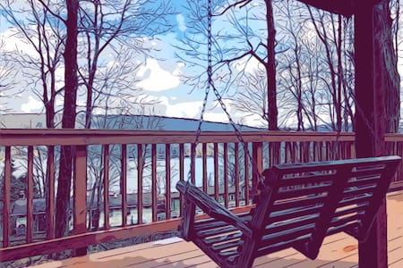 Wooded camp w/lake views/fire pit. Great location.