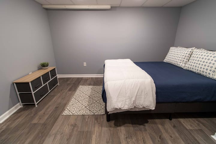 Bedroom 2, queen-sized bed with memory foam mattress.