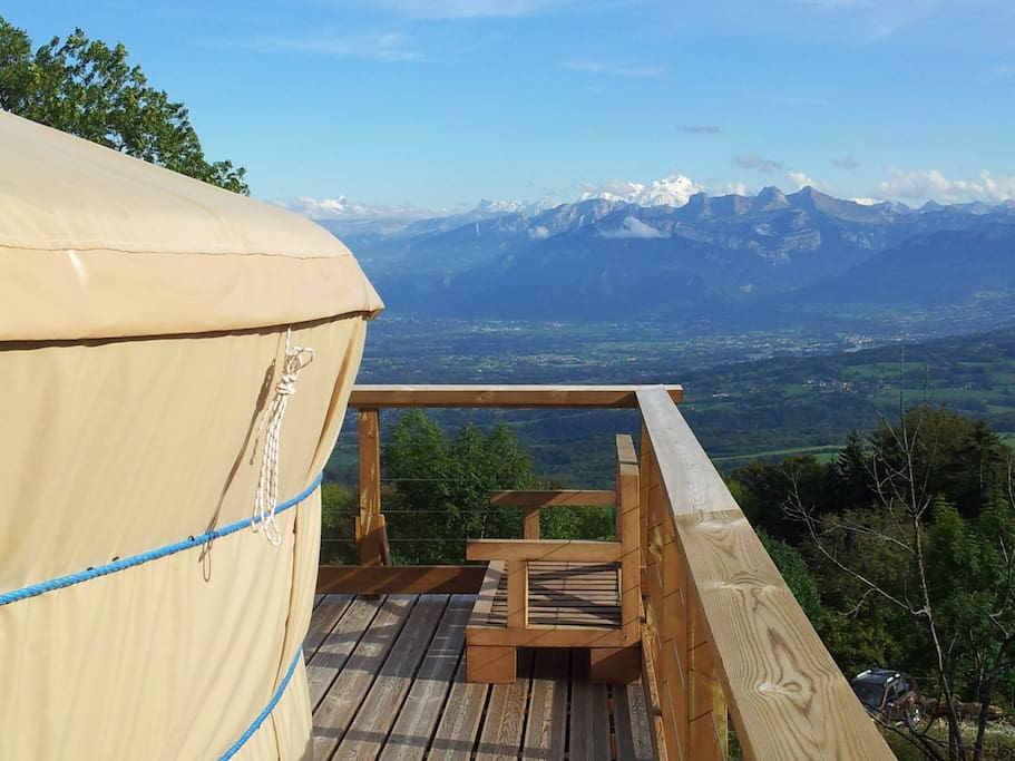 The yurt is on a platform that gives the impression of being suspended