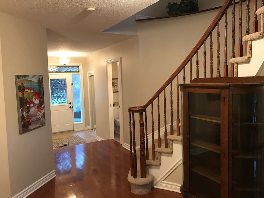 Front entrance, powder room, stairs to 2nd floor.