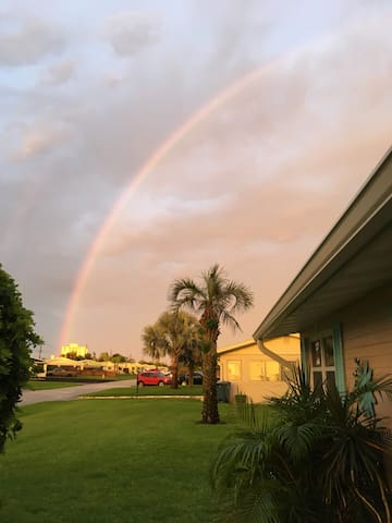 My house after a storm what a beautiful rainbow .