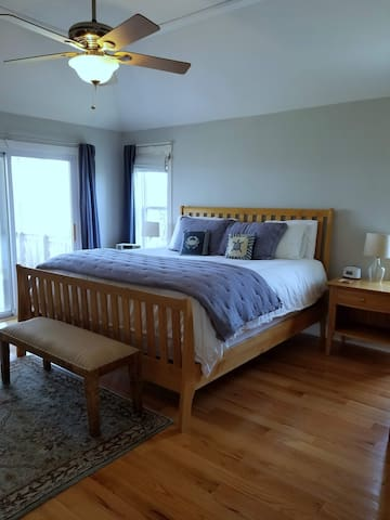 Master king bedroom with fireplace, TV and private balcony.