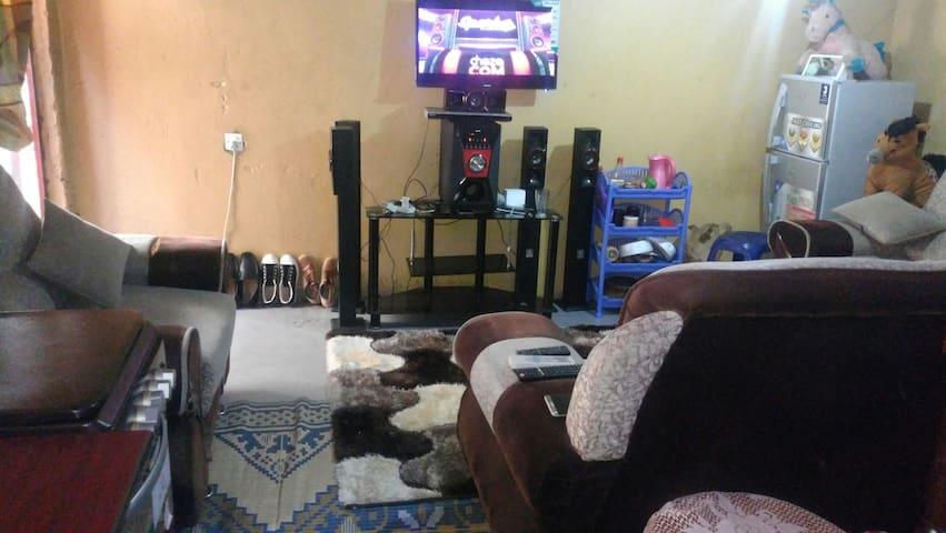 Refregirator,cooker,Tv, sound system, sofa set,bed