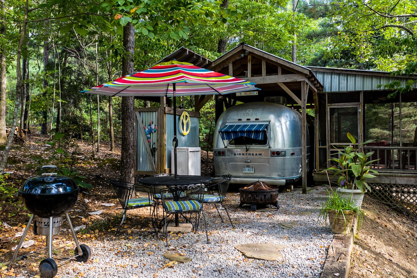 ToNoMo Airstream with outdoor shower, outdoor patio with grill, firepit, table and chairs; and screen porch.  Private location near lakeshore.  Access to swimming, kayaks and paddleboards on large dock.