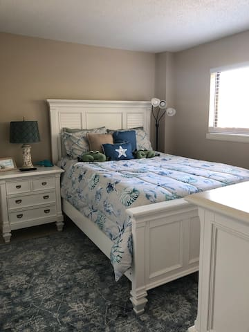 Master Bedroom with Queen Bed and tv.
