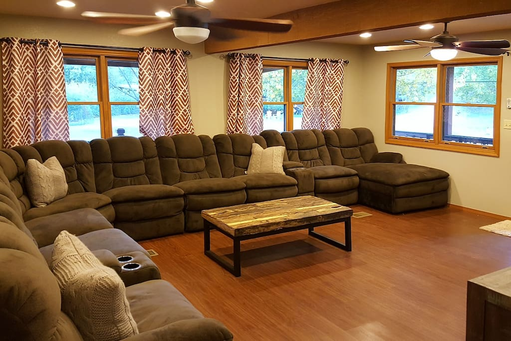 Full wrap-around living room pit group and 4 recliner sections and built in cup holders.