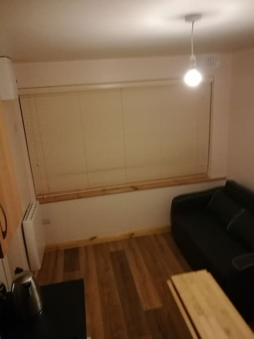Blinds on the Front Window, Sofa bed is in view on the Right, can be Opened very quickly