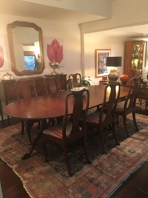 Large dining room table that seats 8 comfortably.