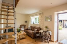 Open plan lounge dining room with woodburner
