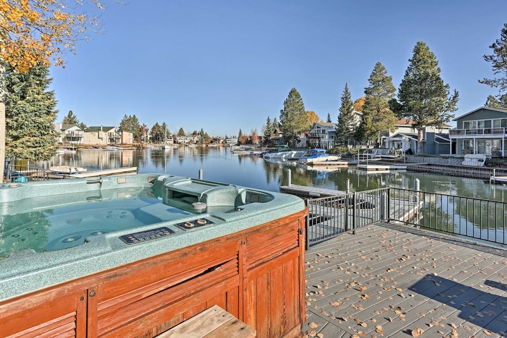 Look forward to relaxing in the private hot tub overlooking the lake.