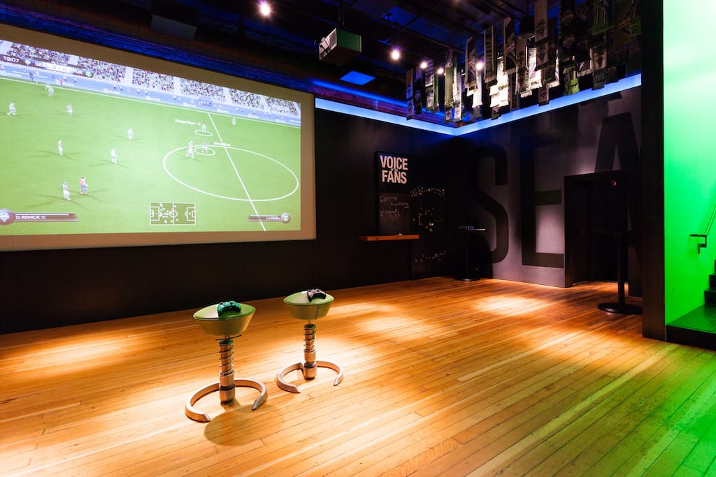 Huge projector TV + FIFA? Welcome to gaming heaven.