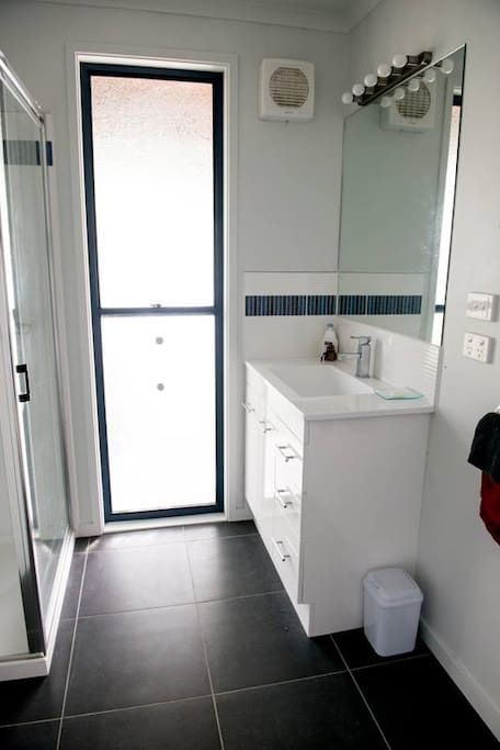 En-suite with shower over the bath.