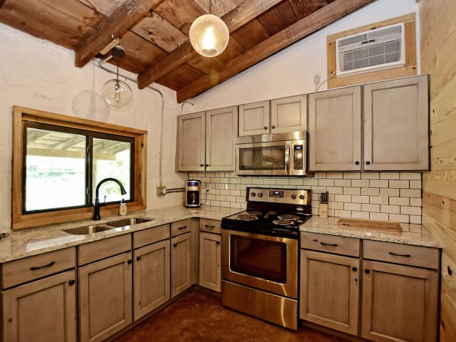 Full kitchen with a refrigerator